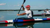 canoe : Male boater is navigating a canoeing vessel Stock Footage