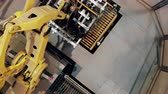 complex system : Top view of a mechanical robotic arm working at factory facility. Industrial revolution 4.0 Stock Footage