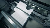 newspaper stack : Printing office machine stacks white paper. Stock Footage