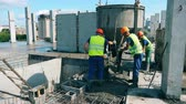 cantaria : Male workers are unloading cement from the barrel