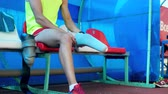 fora : Leg prosthesis is getting assembled by a male athlete Stock Footage