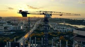 住宅 : Big construction crane on sunset background.