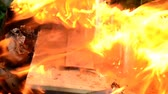 lend : Close-up of sale agreement, contract, paperwork, paper burning. Concept shot of freedom and new beginnings.