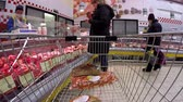 cartn corrugado : 03232016 Minsk, Belarus, hypermarket Euroopt: Buying products in the hypermarket. Buying meat, eggs and products. Stock Footage