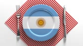 Патагония : National cuisine and dishes of Argentina. Delicious recipes from Europe. Flag on a plate with food from Argentina. Стоковые видеозаписи