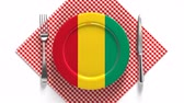 jellegzetes : National cuisine and dishes of Guinea. Delicious recipes from Africa. Flag on a plate with food from Guinea.