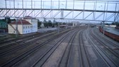 дизель : Passenger train rides the station, top view, time-laps