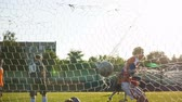 goleiro : BOBRUISK, BELARUS - AUGUST 9, 2017: Goalkeeper Baranowski jumps and misses goal during soccer championship among amateur teams