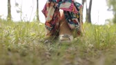 light eyes : Girl takes off skirt in nature, close-up, grass Stock Footage