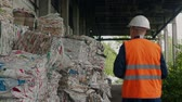 urban waste : inspector and packed garbage of polyethylene in recycling company