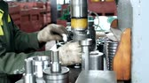 регулировка : The worker at the plant presses the bearing into the hub using a press machine, assembling the hub, assembling the unit for mechanical engineering, close-up, pillow Стоковые видеозаписи