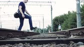 через : man crosses the railroad in the wrong place, life threatening