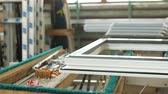 glass material : Production and manufacturing of plastic windows pvc, on the table lies the sash window, screwdriver, the shop is finished products windows Stock Footage