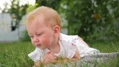 teething : Blue eyed girl smiling outdoor. Child in summer forest. Toddler on the meadow.