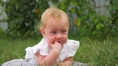 front or back yard : Baby teething concept. Positive emotions idea. Babyhood background.