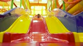 obnova : Child sliding down colorful slide play house in backyard. Sports and recreations for children. Plays and games for kids. Modern lifestyle background. Childs Excitement while sliding down.