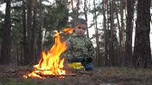 zvěř a rostlinstvo : Social problems background. Escaping from home concept. Child care treatment. Orphan thinking about his parents. Campaign background. Camping idea. Boy alone in the forest.