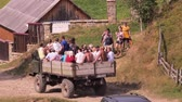 furgone : Unauthorized carriage background. Group of people transporting in the truck. Lots of people in car basket. Lorry car transporting people. Villagers going to celebration. Celebration in the village. Filmati Stock