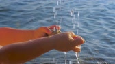 pediatrics : Hot summer day in Europe. Kids hands under the water drops with sea ocean on background. Pure water background. Water drops with hands on sea water background. Abnormally hot summer days