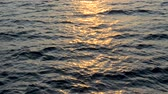 ressam : Background of calm sea. Sea with little waves close up. Deep blue ocean with sun reflecting in the water.