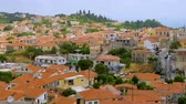 região : Village in the mountains. Greek old city, down town. Travelling Europe. Top view of white houses with red roofs in Greek city Kymi on Evia, Euboea island, Greece. Beautiful cityscape view