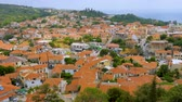 Travel concept. European view of the city, town. Panorama of old city of Kymi, Greece. Houses with red roofs, cityscape of Greek town, village, Greece. Evia Euboea island, Greece. Top view