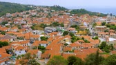 Top view of red roofs of houses, cityscape, Kymi, Greece. Tourism Europe Greece. Town in mountains top view. Architechture of old european city. Top view Archivo de Video