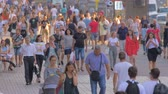 Mass of people walking in the city. Urban people going at a busy city street. Students, tourists going along the street. Urban landscape. A group of people, tourists in sunglasses. Crowd of people walking on street sidewalk