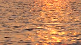 Soft colors of sunset reflects on seawater. Natural soft trendy colors. Seascape, seawater with moon track on the water. Sunset reflecting in seawater. Beauty of the nature Stock mozgókép