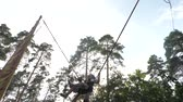Sports and recreation. Bungee jumping sports. Leisure activities outdoor. Boy jumping high. Extreme games for children