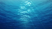 солнечные лучи : Underwater scene with sunrays shining through the waters glittering and moving surface. Looping.