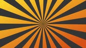 radial : An orange sunburst is rotating . Looping