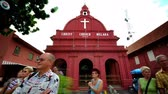 christchurch : MALACCA - SEPTEMBER 22: Tourist activity in front Christ Church Malacca September 22, 2009 in Malacca State, Malaysia. Stock Footage