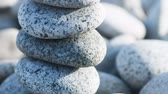 zen like : Zen. Pile of pebble Stones with back light.