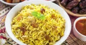 rozinky : Arab rice, Ramadan food in middle east usually served with tandoor lamb. Middle eastern food. 4k footage video.