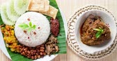 curry : Nasi lemak, traditional Malay curry paste rice dish, 4k footage video.