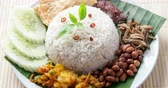 singapore : Nasi lemak, traditional Malay curry paste rice dish, 4k footage video.