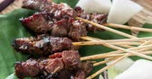 raya : Malaysian satay with delicious peanut sauce, one of famous local dishes. 4k footage video. Stock Footage