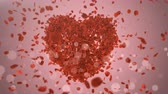 crumble : Romantic red rose petals fly from the heart.Wedding.