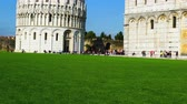 field : Pisa, Italy - October 19, 2015 : Tourists walking at the Baptistery in the Square of Miracles in Pisa, Tuscany, Italy on October 19, 2015.