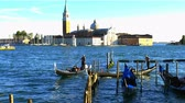 wood : Venice, Italy - October 20, 2015 : Gondolas and passengers on the grand canal of Venice, Italy on October 20, 2015. Stock Footage