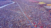 birdseye : Aerial view of shacks of buddhist monks in Yarchen Gar Monastery in Sichuan, China Stock Footage