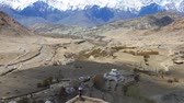 ladakh : View of snowy Himalayan mountain range and a stupa in buddhist temple at Ladakh in Kashmir, India Stock Footage