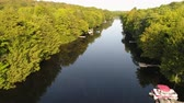 Low Altitude to High tracking shot over the Muskoka River Stock Footage