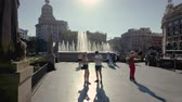 Barcelona, Spain - September 2017. Tourists taking photos next to a fountain in Placa de Catalunya.
