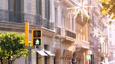 Green to red traffic light for pedestrians in a street of Barcelona Stok Video