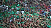 catalão : Tarragona, Spain. October 2018: Castells Performance in the XXVII Tarragona Human Tower Competition. A castell is a human tower built traditionally in festivals within Catalonia. Vídeos