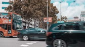 Timelapse of busy pedestrian and car crossing at Barcelona city center