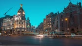 Madrid, Spain. June 2019: Timelapse central madrid on the crossing Alcala and Gran Via street in Madrid by twilight