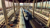 AVE High-speed train arriving at Madrid Puerta de Atocha Train station top view Stock Footage